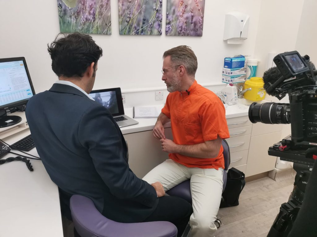 Dr Atkins reviews Illegal tooth whitening footage with the BBC reporter.